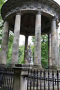 The circular neo-Roman St. Bernard's Mineral Well on the Water of Leith near Dean Village, on 26th June 2019, in Edinburgh, Scotland. The St Bernard's Well as we have it today was constructed in 1789 to a design by celebrated Edinburgh landscape painter Alexander Nasymth drawing inspiration from the Temple of Vesta at Tivoli in Italy. At the centre of an open pillared dome stands a marble statue of Hygieia, Goddess of Health.