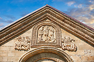 Pictures & images of Nikortsminda ( Nicortsminda ) St Nicholas Georgian Orthodox Cathedral exterior and its Georgian relief sculpture stonework depicting saints an St George slaying the dragon, 11th century, Nikortsminda, Racha region of Georgia (country). A UNESCO World Heritage Tentative Site. .<br /> <br /> Visit our MEDIEVAL PHOTO COLLECTIONS for more   photos  to download or buy as prints https://funkystock.photoshelter.com/gallery-collection/Medieval-Middle-Ages-Historic-Places-Arcaeological-Sites-Pictures-Images-of/C0000B5ZA54_WD0s<br /> <br /> Visit our REPUBLIC of GEORGIA HISTORIC PLACES PHOTO COLLECTIONS for more photos to browse, download or buy as wall art prints https://funkystock.photoshelter.com/gallery-collection/Pictures-Images-of-Georgia-Country-Historic-Landmark-Places-Museum-Antiquities/C0000c1oD9eVkh9c