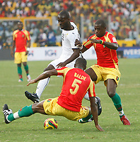 Photo: Steve Bond/Richard Lane Photography.<br />Ghana v Guinea. Africa Cup of Nations. 20/01/2008. Quincy Owusu-Abiyie (L) tries to get past Daouda Jab (R). Bobo Balde (lower) dives in