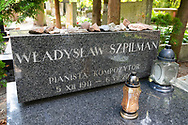 Warsaw, Poland - August 19, 2016: The grave of Władysław Szpilman (December 5, 1911 – July 6, 2000) at Powązki Military Cemetery in Warsaw. Szpilman was a Polish pianist, a classical composer, and a Jew who survived the Holocaust. He was the subject of The Pianist, a 2002 film by Roman Polanski.