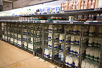 Empty shelves at Asda Totton as people stockpile food and cleaning supplies as fears grow of a 14 day quarantine uk photo by Michael Palmer