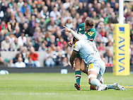 Picture by Andrew Tobin/Focus Images Ltd +44 7710 761829.25/05/2013. Courtney LAWES of Northampton late tackled Toby Flood (C) of Leicester for a 2nd time during the Aviva Premiership match at Twickenham Stadium, Twickenham.