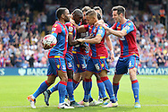 Dwight Gayle of Crystal Palace © celebrates with his team mates  after scoring his sides 1st goal to make it 1-1. Barclays Premier League match, Crystal Palace v Stoke City at Selhurst Park in London on Saturday 7th May 2016. pic by John Patrick Fletcher, Andrew Orchard sports photography.