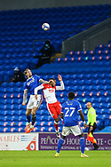 Cardiff City's Aden Flint (5) competes for a high ball with Millwall's Kenneth Zohore (13) during the EFL Sky Bet Championship match between Cardiff City and Millwall at the Cardiff City Stadium, Cardiff, Wales on 30 January 2021.