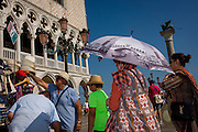 Tourist umbrella in Piazza San Marco, Venice, Italy