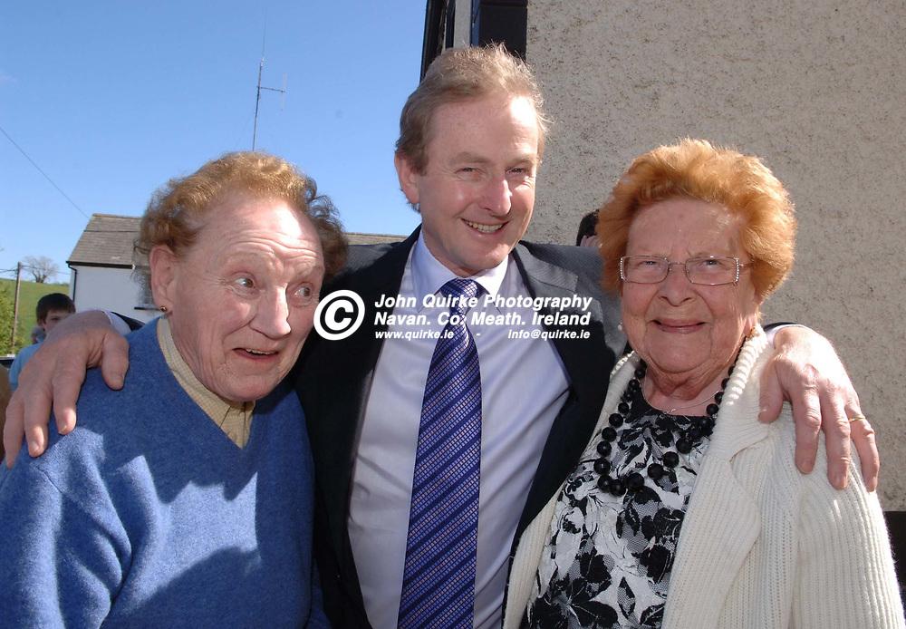 18-04-07. <br /> Enda Kenny, T.D. Leader of Fine Gael on a pre election visit to Nobber.<br /> L to R: Mona McEntee, Enda Kenny, T.D., and Bridie McEntee.<br /> Photo: John Quirke / www.quirke.ie<br /> ©John Quirke Photography, Unit 17, Blackcastle Shopping Cte.<br /> Navan. Co. Meath. 046-9079044 / 087-2579454.