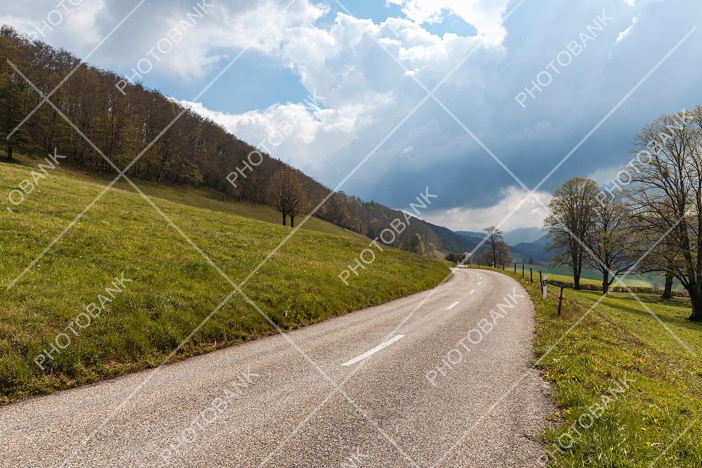 Isolated road in the Swiss Alps of the Jura Canton. Nobody inside. Cloudy day