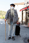 food shopper coming from the farmers market during Covid 19 crisis and lockdown France Limoux April 2020