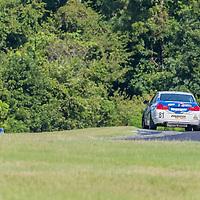 Alton, VA - Aug 26, 2016:  The BimmerWorld Racing BMW 328i races through the turns at the Oak Tree Grand Prix at Virginia International Raceway in Alton, VA.