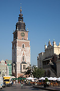 Town Hall Tower in Kraków Main Market Square (left) & Sukiennice or cloth hall at right, Poland