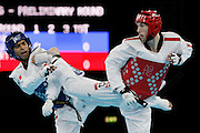 Mcc0041438 . Daily Telegraph..DT Sport..2012 Olympics..Team GB's Martin Stamper vs Mexico's Erick Osornio Nunez  in the Taekwondo  Mens -68 kg preliminary rounds at the ExCel centre...9 August 2012....
