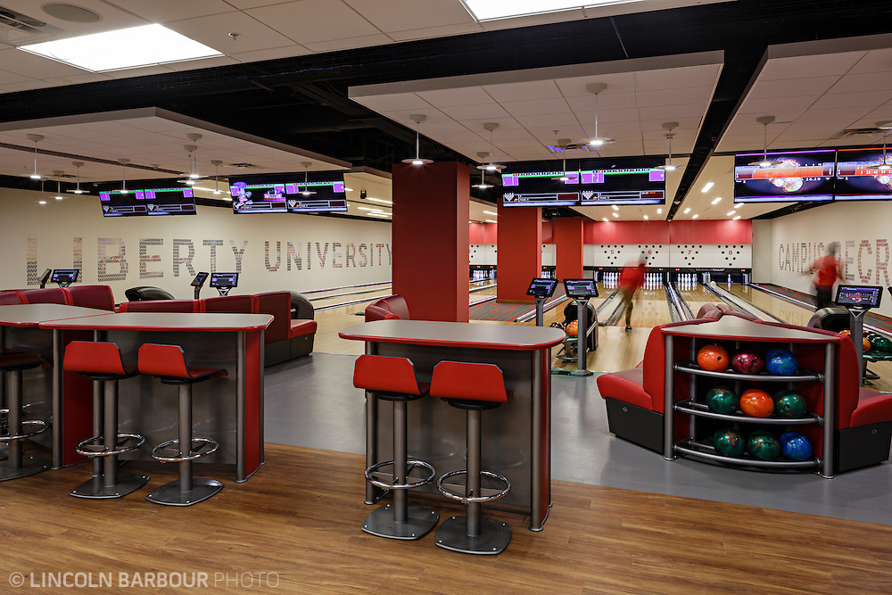Bowling lanes inside the Liberty Student Center.  People are actively bowling.