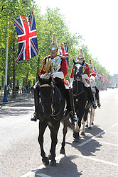 © licenced to London News Pictures.London,UK..27/04/2011.Royal Wedding Preparations.Captain Edward Olver (front rider) on The Mall.making up the Queen's life guard before the Royal Wedding. .Please see Special Instructions..Picture credit should read Grant Falvey/London News Pictures