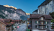 Jungfrau and moon, seen at sunset from Hotel Oberland, Lauterbrunnen, Switzerland, the Alps, Europe. This image was stitched from multiple overlapping photos.