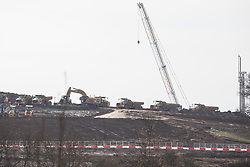 Harefield, UK. 13th February, 2021. Trucks and heavy machinery being used close to Harvil Road in the Colne Valley for the HS2 high-speed rail link. The area had previously been cleared of trees and vegetation.