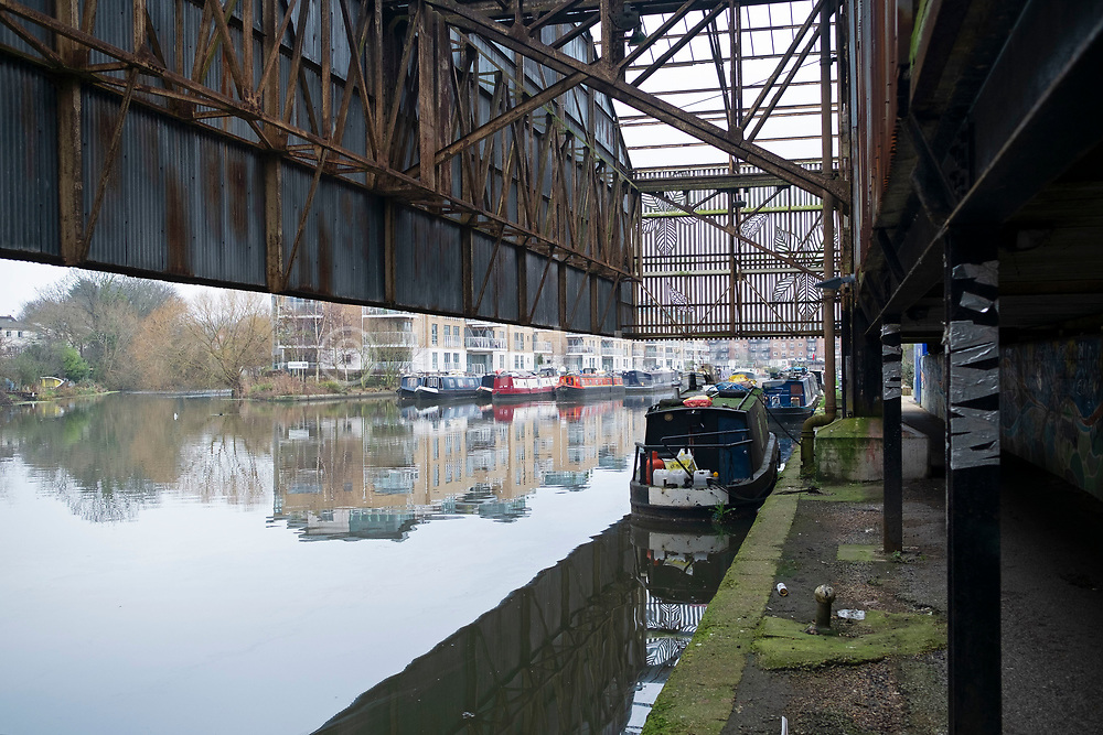 Disused canopy of an old boat yard where goods would once have been taken on and off barges along the Grand Union Canal near Osterly Lock on 25th January 2020 in London, United Kingdom. This section of canal towpath along what is also known as the River Brent, is part of the Capital Ring walk.