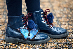 © Licensed to London News Pictures. 28/03/2018. London, UK. A butterfly lands on the shoes of Freya Gordon, aged 10, at the 'Sensational Butterflies' exhibition at the Natural History Museum, returning for it's tenth year. Photo credit : Tom Nicholson/LNP