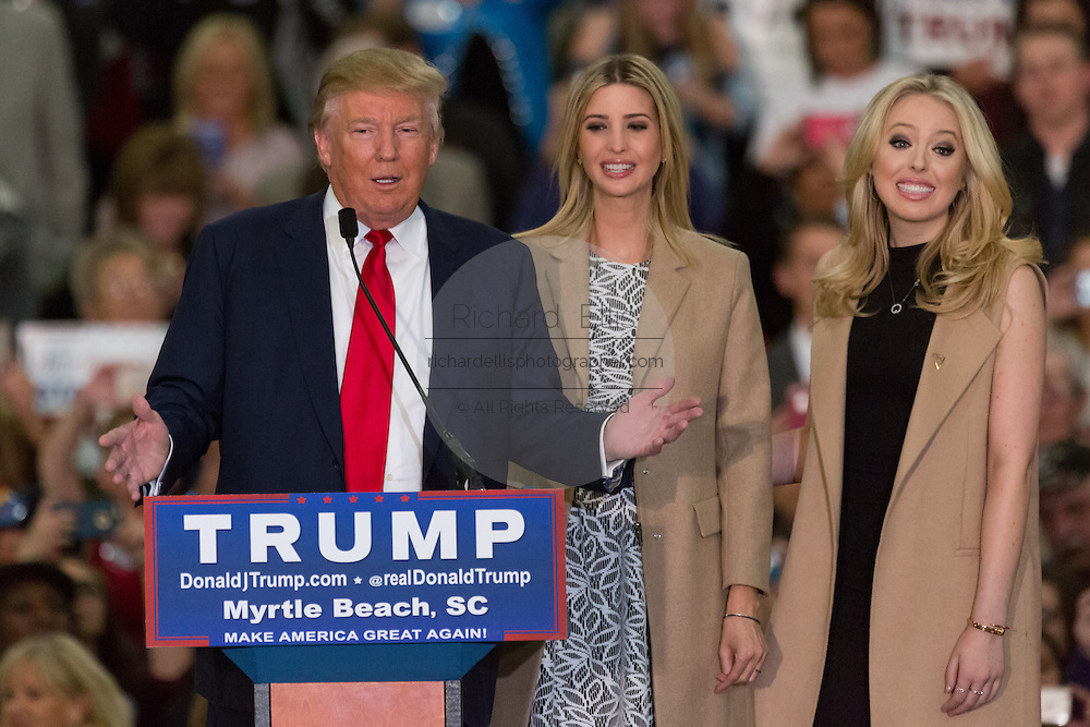 Republican presidential candidate billionaire Donald Trump introduces his daughters Ivanka, center, and Tiffany during a campaign rally at the Myrtle Beach Convention Center November 24, 2015 in Myrtle Beach, South Carolina.