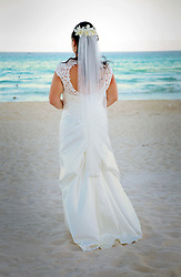 08 Feb 2014. Cancun, Mexico.<br /> Laurence Yates and Geraldine Lim are married on the beach in front of family and friends at the Beach Palace Hotel.<br /> Photo; Charlie Varley/varleypix.com