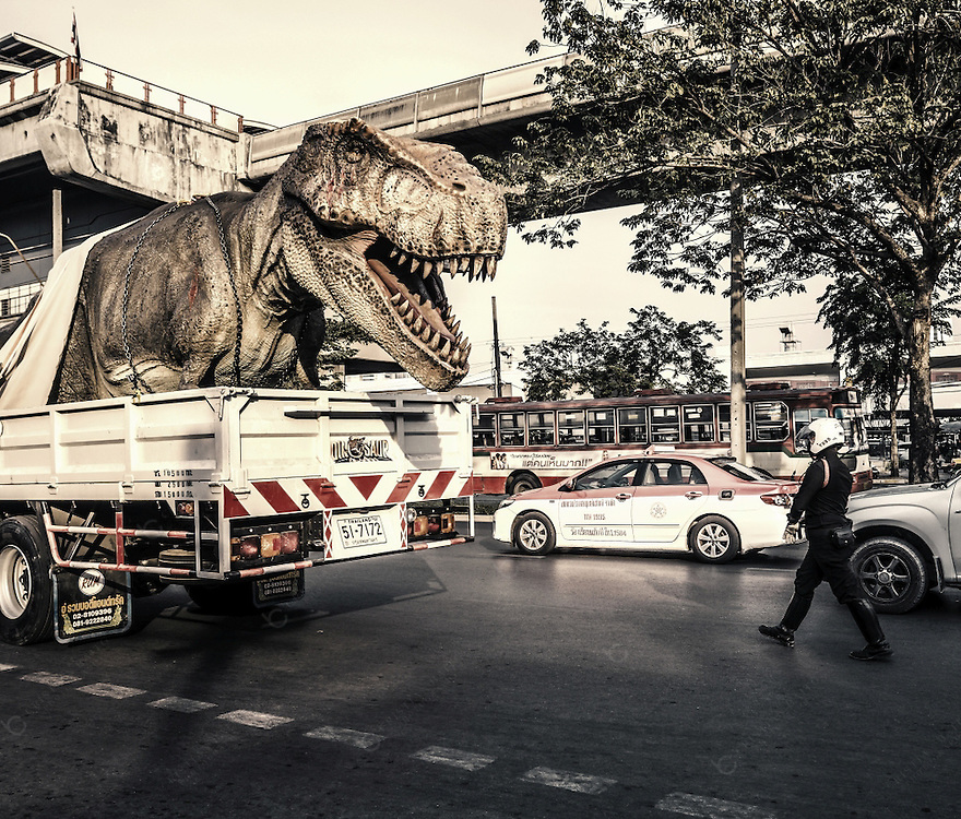 A Tyrannosaurus Rex movie prop being transported in the streets of Bangkok Thailand