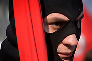 Moscow, Russia, 01/05/2005..Demonstrators from a wide range of political groups take to the streets on the traditional Russian Mayday holiday to protest against President Vladimir Putin and the Russian government..Masked members of the extreme communist Red Youth Vanguard.