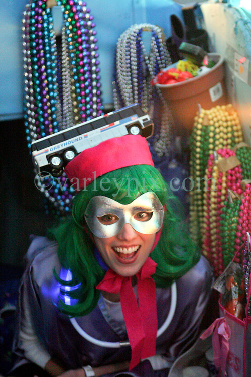 Feb 23rd, 2006. New Orleans, Louisiana. The Krewe of Muses. Muses is the only all women's Krewe to parade in New Orleans and is known for its satire, famous shoe throws and is generally considered one of the most popular parades of the Mardi Gras.  Women load up on their floats ready for the parade.