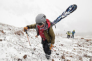 Backcountry skiers climb the loose talus slopes of Hayden Peak, San Juan Mountains, Colorado.