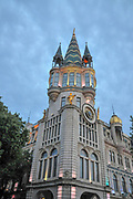Astronomical clock tower, on the restored facade of the former National Bank building in Europe park, Batumi, Georgia Photographed at night