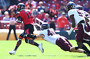 Southern Illinois Salukis linebacker Cory Lee (40) tackles Southeast Missouri State Redhawks wide receiver Paul McRoberts (11) in the first quarter. The Southern Illinois University - Carbondale (SIUC) Salukis defeated the host Southeast Missouri State University (SEMO) Redhawks 36-19 in an NCAA football game at Busch Stadium on Saturday September 21, 2013.