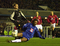 Photo. Richard Lane. <br />Birmingham City v Manchester United. Barclaycard Premiership. 04/02/2003<br />Roy Carroll has a scarry moment as Chreistophe Dugarry gets on the end of a back pass.