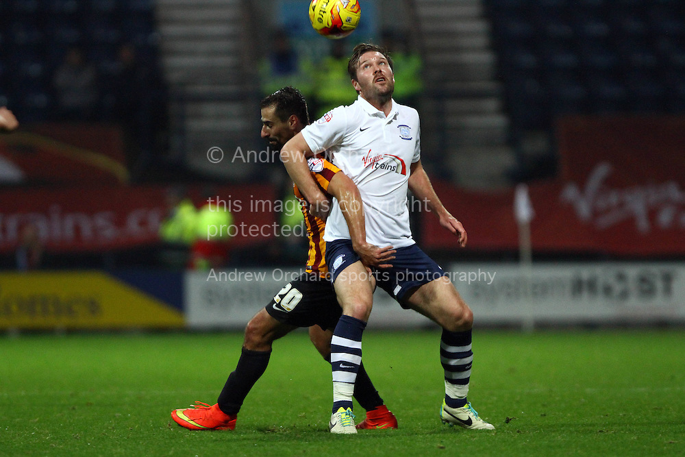 Bradford City's Filipe Morais and Preston North End's Scott Laird battle for the ball. Skybet football league one match, Preston North End v Bradford city at Deepdale in Preston, Lancs on Saturday 15th November 2014.<br /> pic by Chris Stading, Andrew Orchard sports photography.