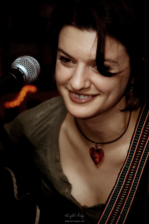 """Kassandra Vox on guitar and vocals accompanied by Keith Bessette on mandolin at a memorable Bus Stop Music Cafe """"After Hours"""" session."""