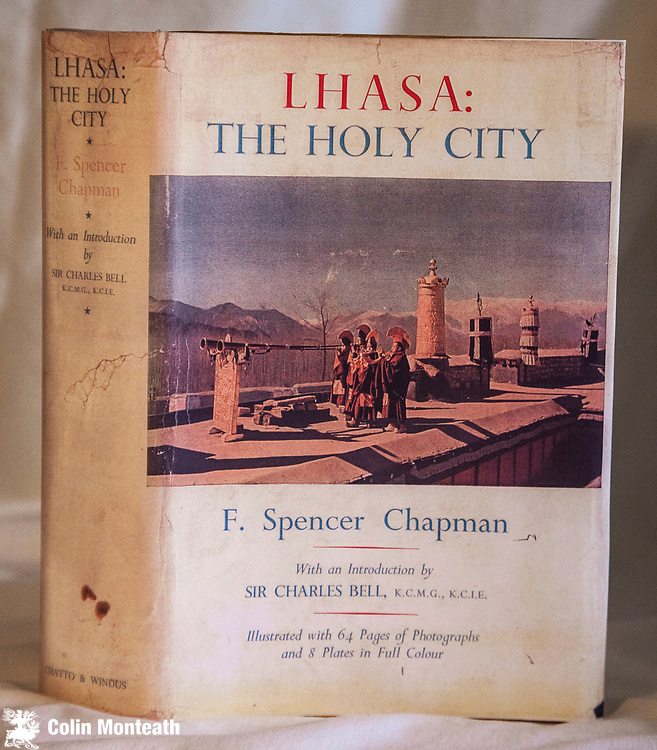 LHASA THE HOLY CITY - F Spencer Chapman - Chatto & Windus, London, 1st UK Edn: 1938, Introduction by Sir Charles Bell, original yellow cloth mottled, facsimile of original dustjacket, fold-out map, numerous B&W & colour plates, Some internal foxing but overall a good solid copy of a scarce book - English mountaineer Spencer Chapman joined Charles Bell's delegation to Lhasa overland from Sikkim past Chomolhari  (Chapman later made the first ascent).  - $NZ140