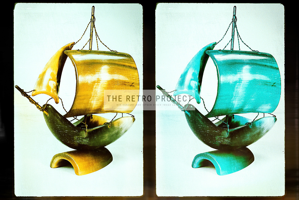 Vintage distressed aged carved horn ship model studio image repeat on photo frame background