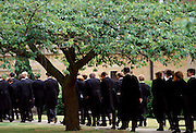 Eton schoolboys in traditional tails at Eton College, England, UK