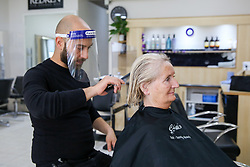 © Licensed to London News Pictures. 04/07/2020. London, UK. SHEILA, a client at Cheriee hair salon on Green Lanes in Harringay, gets her hair cut as the salon reopens on Super Saturday. Cafes, restaurants, pubs and hairdressers across the UK closed on 23 March following the coronavirus lockdown. As restrictions are eased, cafes, restaurants, pubs and hairdressers reopens today. Photo credit: Dinendra Haria/LNP