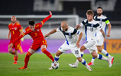 HELSINKI, FINLAND - Thursday, September 3, 2020: Wales' Dylan Levitt (L) challenges Finland's Teemu Pukki during the UEFA Nations League Group Stage League B Group 4 match between Finland and Wales at the Helsingin Olympiastadion. (Pic by Jussi Eskola/Propaganda)