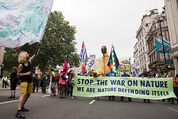 London, UK. 4th September, 2021. Extinction Rebellion climate activists take part in a colourful March for Nature on the final day of their two-week Impossible Rebellion. Extinction Rebellion are calling on the UK government to cease all new fossil fuel investment with immediate effect.