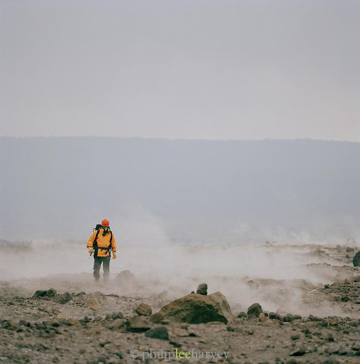 A man stides through Hawaii Volcanoes National Park, Hawaii, USA