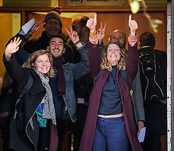 © Licensed to London News Pictures. 22/12/2016. London, UK. A group of protestors, including SOPHIA LYSACZANKO (Right in purple coat) look defiant as they arrive at Ealing Magistrates Court in London.  protestors are charged with Wilful Obstruction of the Highway after blocking an access road to Heathrow on November 18, 2016. Photo credit: Ben Cawthra/LNP