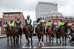 © Licensed to London News Pictures. 14/07/2012. Bristol, UK. Heavy police presence in Bristol during the EDL and counter EDL marches. Protestors were separated by large numbers of police throughout the day.  Photo credit : David Mirzoeff/LNP