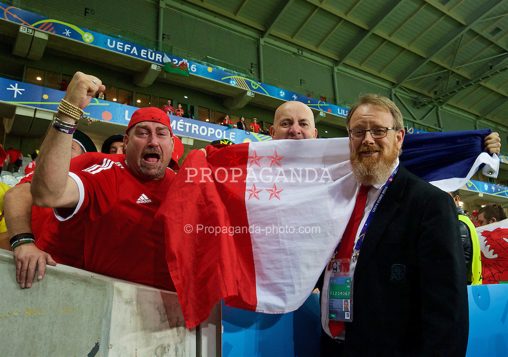 LILLE, FRANCE - Friday, July 1, 2016: Wales' head of international affairs Mark Evans and supporters celebrate after a 3-1 victory over Belgium and reaching the Semi-Final during the UEFA Euro 2016 Championship Quarter-Final match at the Stade Pierre Mauroy. (Pic by David Rawcliffe/Propaganda)