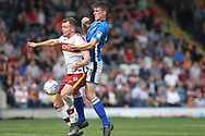 Ryan Delaney challenges Charlie Wyke during the EFL Sky Bet League 1 match between Rochdale and Bradford City at Spotland, Rochdale, England on 21 April 2018. Picture by Daniel Youngs.