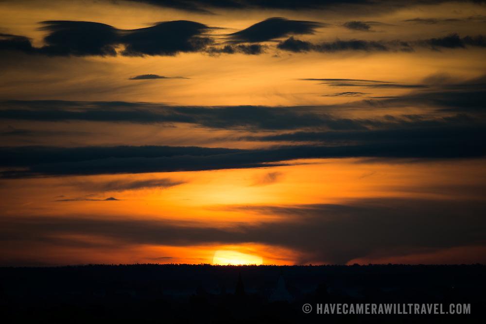 BAGAN, Myanmar (Burma) - A dramatic skyscape at sunrise over the plain of Bagan, Myanmar.