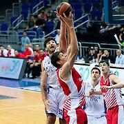 Anadolu Efes's Deniz Kilicli (L) during their Gloria Cup Basketball Tournament match Anadolu Efes between Crvena Zvezda at Ulker Sports Arena in istanbul Turkey on Friday 26 September 2014. Photo by Aykut AKICI/TURKPIX