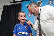 Mascot being interviewed during the EFL Sky Bet League 1 match between AFC Wimbledon and Shrewsbury Town at the Cherry Red Records Stadium, Kingston, England on 14 September 2019.
