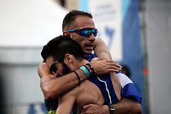 November 12, 2017 - Athens, Attica, Greece - Greek runners hug at the finish line at the 35th Athens Classic Marathon in Athens, Greece, November 12, 2017. (Credit Image: © Giorgos Georgiou/NurPhoto via ZUMA Press)