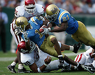 UCLA's Brandon Breazell is tackled by the Oklahoma defense during the Bruins' 41-24 victory over Oklahoma at the Rose Bowl in Pasadena Saturday September 17, 2005.
