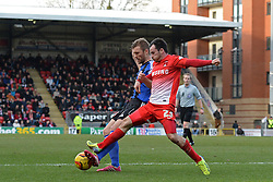 Swindon's Darren Ward and Orient's Chris Dagnall compete for the ball - Photo mandatory by-line: Mitchell Gunn/JMP - Tel: Mobile: 07966 386802 22/02/2014 - SPORT - FOOTBALL - Brisbane Road - Leyton - Leyton Orient V Swindon Town - League One