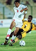 Fotball<br /> Afrikamesterskapet/African Nations Cup 2002<br /> Zambia v Tunisia<br /> Foto: Digitalsport<br /> NORWAY ONLY<br /> JAMEL ZABI (TUN) / ELIJAH TANA (ZAM)
